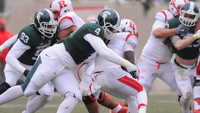 MSU's Malik McDowell hauls down Rutgers running back Josh Hicks for a loss on Saturday. MSU's Malik McDowell hauls down Rutgers running back Josh Hicks for a loss in East Lansing Saturday 11/22/2014. (Rod Sanford | Lansing State Journal)