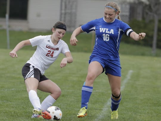 Lourdes Academy's Ellie DeGroot (24) makes a move around