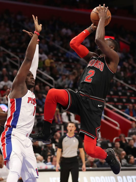 Chicago Bulls guard Jerian Grant, right, shoots as Detroit Pistons guard Reggie Jackson, left, defends during the first half of an NBA basketball game, Saturday, March 24, 2018, in Detroit. (AP Photo/Carlos Osorio)