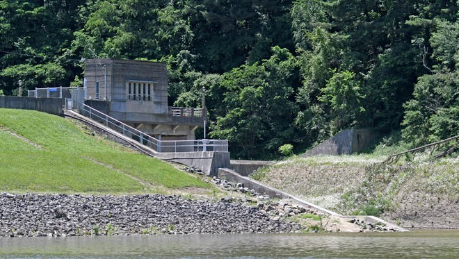 An 18-year-old Lakeville woman was hospitalized and in critical condition after being pulled from the Charles Mill dam spillway overnight.