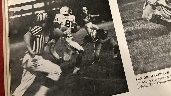 The Washington High School Post yearbook shows George McGinnis running the ball against Scecina as a junior in 1967.