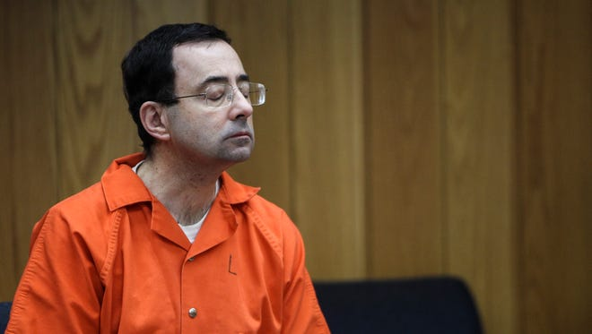 Larry Nassar listens as lead prosecutor Angela Povilaitis makes her closing statements Monday, Feb. 5, 2018, the third and final day of sentencing in Eaton County Court in Charlotte, Mich., where Nassar will be sentenced on three counts of sexual assault.  [MATTHEW DAE SMITH/Lansing State Journal]