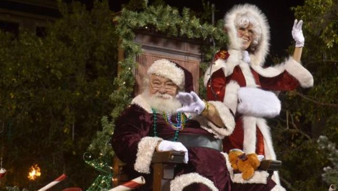 Santa and Mrs. Claus arrive in Pensacola on top of the Seville Quarter fire truck at the 2014 Cox Pensacola Christmas Parade.