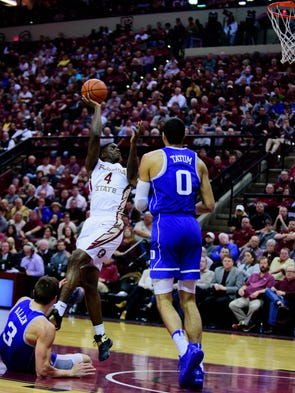Dwayne Bacon (4) shoots for two during the 88-72 Florida