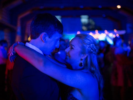 Juniors Luke Kirk, 17, and Haley Plump, 17, dance at the Reitz High School Prom at Burdette Park's Discovery Lodge Saturday night.