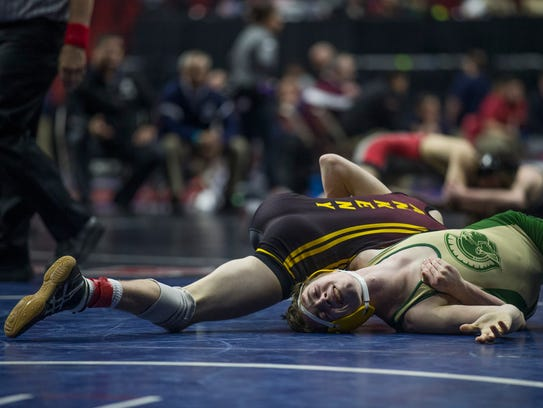 Ankeny's Caleb Rathjen wrestles Iowa City West's Hans
