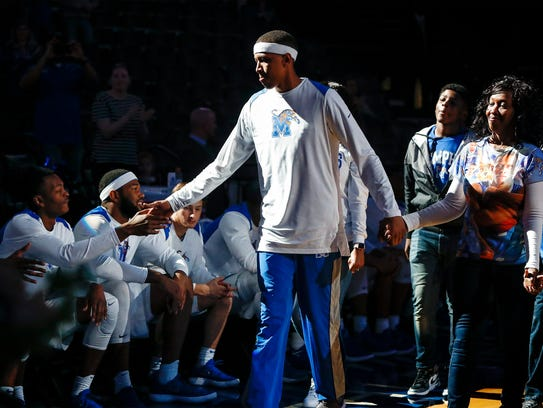 Memphis forward Jimario Rivers (middle) along with this family greets his teammates during Senior Night activities before taking on ECU on Sunday.
