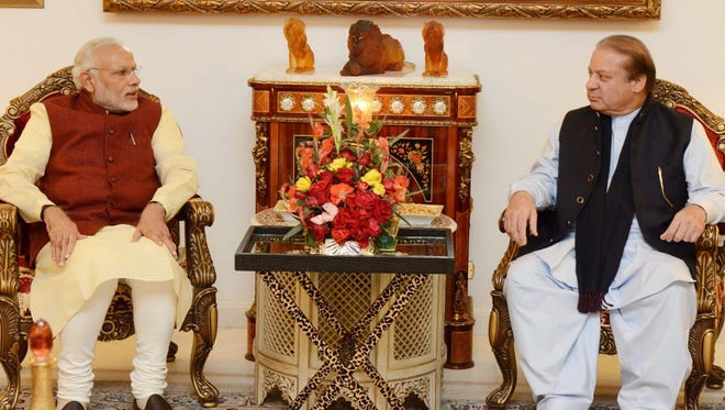 Pakistani Prime Minister Nawaz Sharif, right, meets Indian counterpart Narendra Modi in Lahore, Pakistan, on Dec. 25, 2015. Modi arrived in Pakistan on his first visit as prime minister to this Islamic nation that has been India's long-standing archrival in the region.