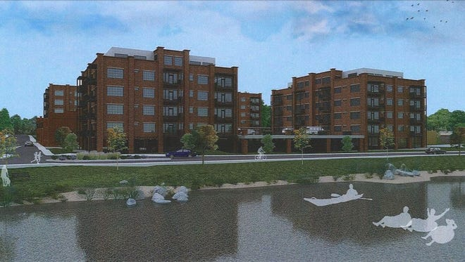 The Stoneyard Apartments proposed for 175 Lyman St. in the River Arts District have been delayed but the project is still a go, the developer says. It will include 133 apartments in four separate buildings.