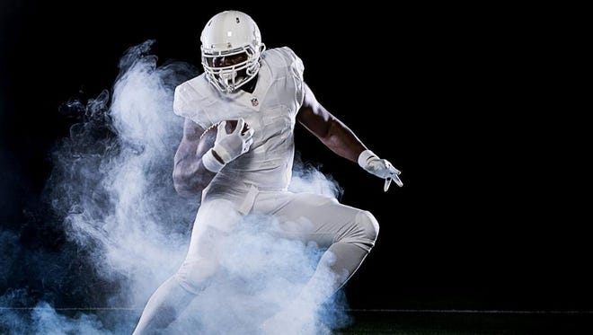 Colts TE Dwayne Allen shows off the team's new all-white jerseys.