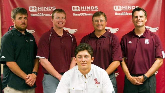 Crockrell (middle) is flanked by (left to right) assistant coach Dylan Belanger, assistant coach Wes Thigpen, head coach Sam Temple and assistant coach Dan Rives as he signs a national letter of intent with Ole Miss.