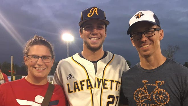 Laura, left, and Caleb Fritz pose with Griffin Robinson,  center, whom they hosted as part of the Lafayette Aviators host family program last summer.