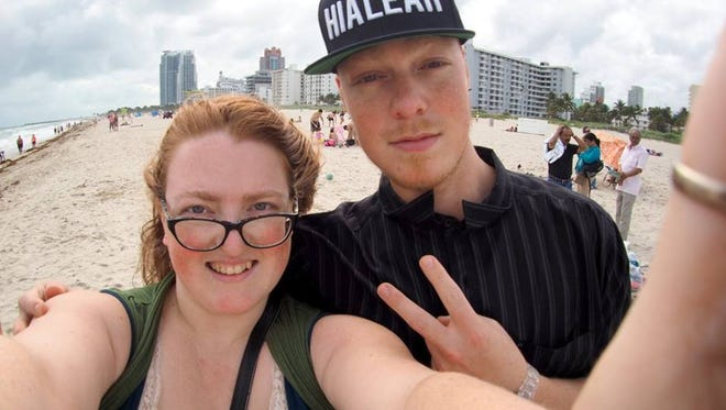 Taima Kern, at left, poses with her brother Keenan on the beach in Miami in 2015. Keenan's chosen to stay in Miami as Hurricane Irma approaches, and wait it out.