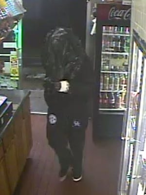 An image from surveillance video shows a man with a trash bag over his head who tried to rob The Milk House on March 3, 2016.