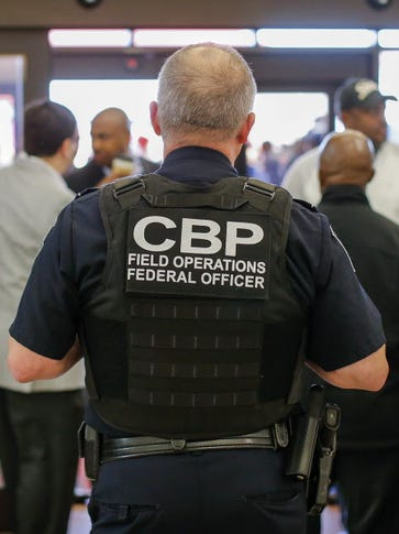 A Customs and Border Protection officer at work in
