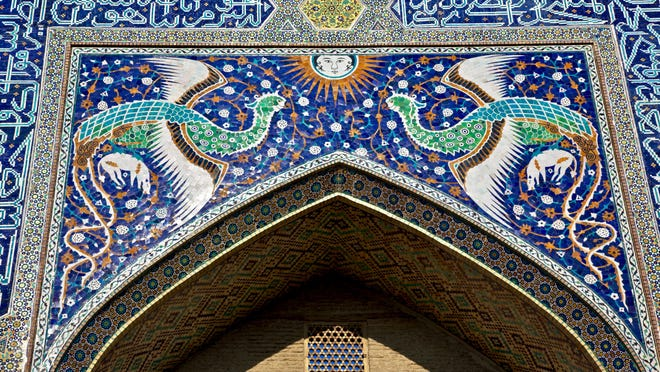 """The Khanaka of Nadir Divan-begi from Bukhara in 1620. The Khanaka was a center for Sufi (Islamic mystic) meetings. The entryway is adorned with images of the Simurgh, and the """"celestial sun"""" at the moment of divine illumination as described in Attar's """"Conference of the Birds."""""""