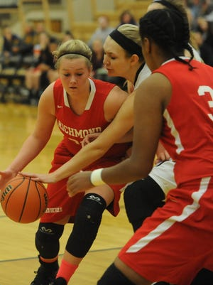 Richmond's Hannah Goddard, left, grabs a loose ball during Friday night's sectional semifinal at Mt. Vernon.