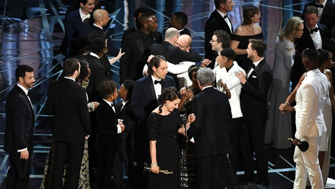 Producer Adele Romanski (center), writer/director Barry Jenkins, producer Jeremy Kleiner and cast/crew members accept the award for best picture for 'Moonlight' onstage during the 89th Annual Academy Awards at Hollywood & Highland Center on Feb. 26, 2017, in Hollywood.