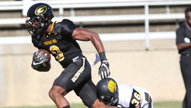 Grambling wide receiver Dominque Leake avoids being tackled by University of Arkansas at Pine Bluff defensive back Kyle Noel to score a touchdown during the Tigers' homecoming game at Robinson Field on Saturday, October 29, 2016.