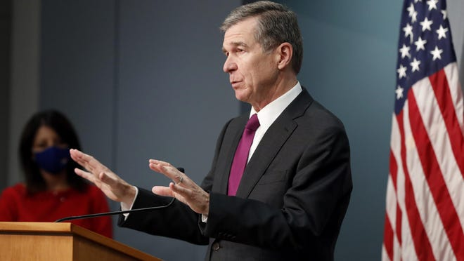 Gov. Roy Cooper announced the easing of COVID-19 restrictions on bars, movie theaters and entertainment venues Wednesday, although the businesses will still have to operate under capacity limitations.