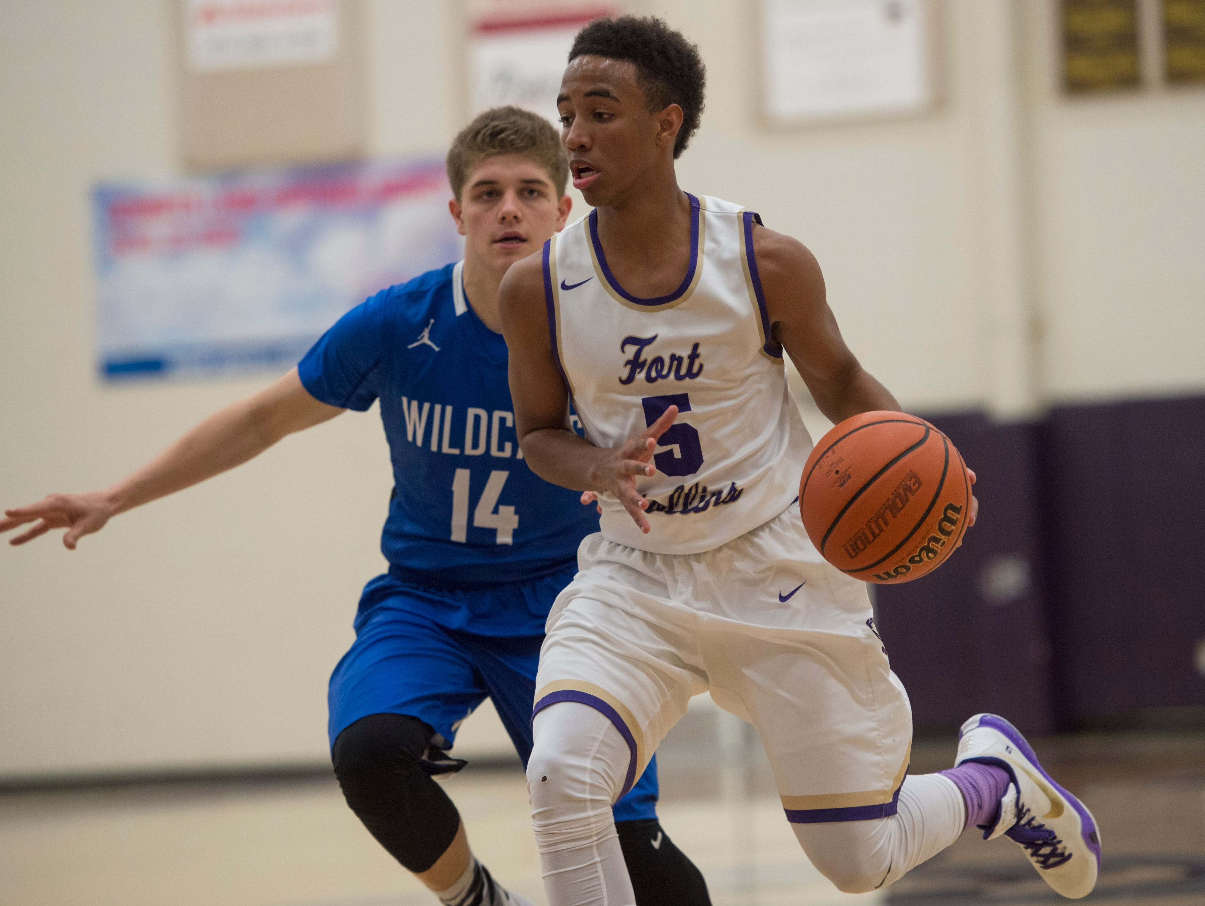 Fort Collins' Iseri Palacio drives past a Fruita Monument defender during the Lambkins 61-34 first-round home win on Wednesday.