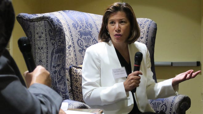 California Chief Justice Tani Cantil-Sakauye, right, talks with attorney John Hager before a gathering of local judges and attorneys Thursday night in Santa Barbara. The event, focused on controversial rulings, brought bar members from Ventura, Santa Barbara and San Luis Obispo counties.