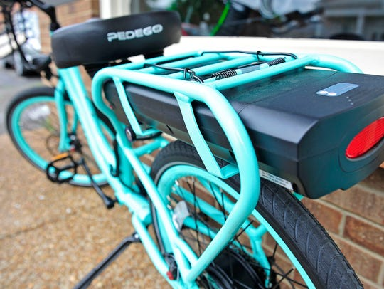 An electric bike has a rechargeable battery pack at