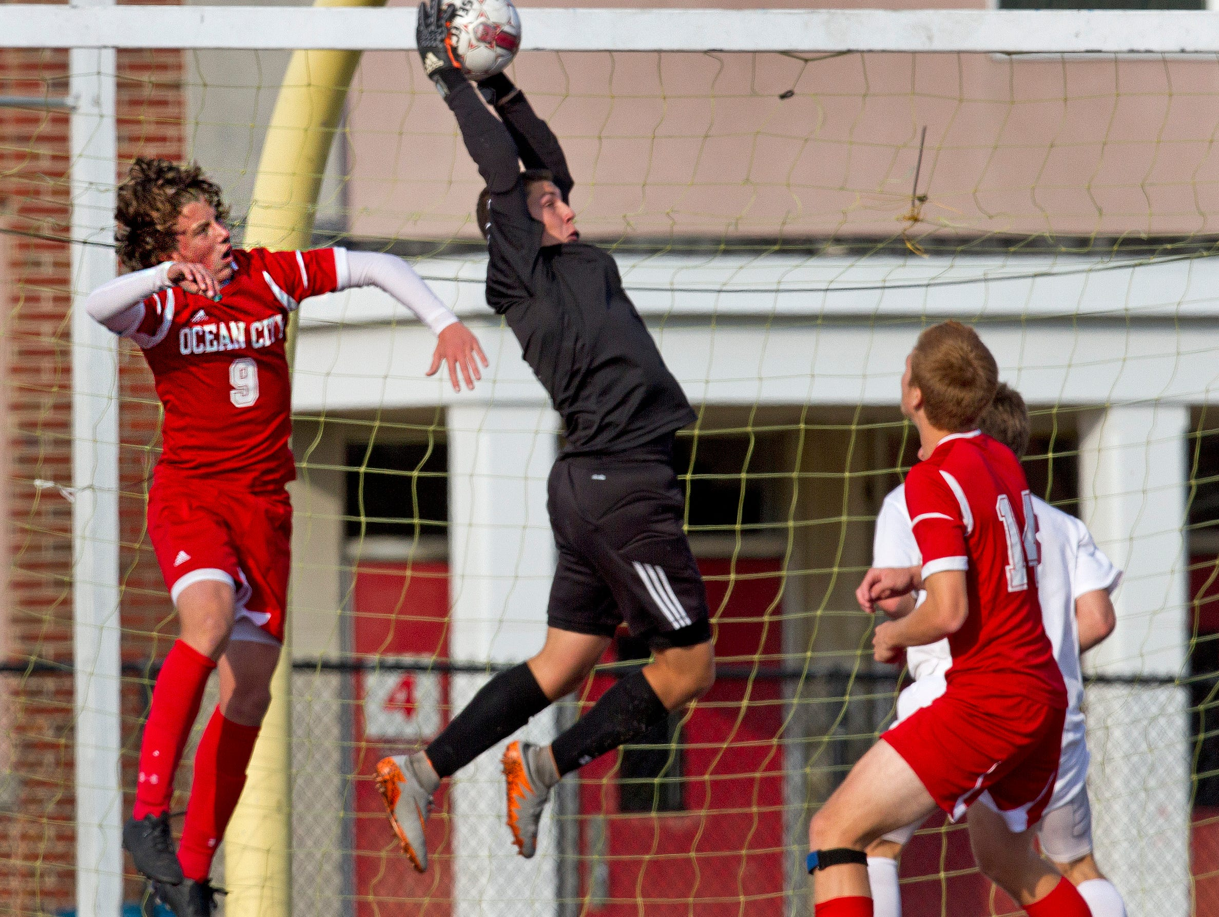 Toms River South goalie Dom Pizzi pulls down a lone shot on goal before Ocean City's Josiah Nistorenko can get his head on it. Toms River South vs Ocean City in NJSIAA Boys Group Soccer Final on November 13, 2015