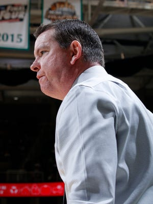 Binghamton coach Tommy Dempsey gives instructions during the first half of an NCAA college basketball game against Michigan State on Saturday, Dec. 5, 2015, in East Lansing, Mich.