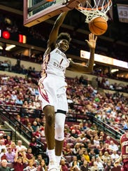 Jonathan Isaac dunks the ball into the basket during