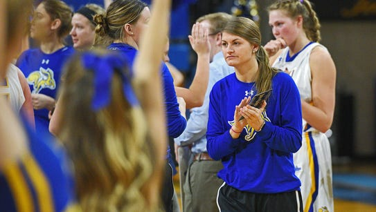 SDSU's Macy Miller celebrates with her team after their