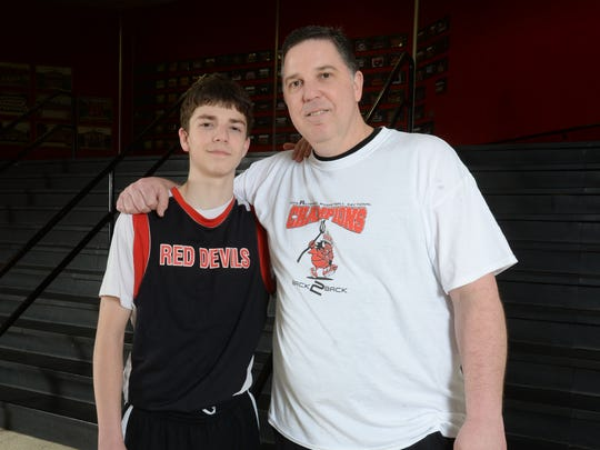 Tommy Luce, left, with dad and coach Joe Luce, Wednesday, March 18, 2015, at the Tiernan Center in Richmond.