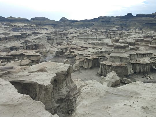 The Farmington Convention and Visitors Bureau encourages residents and visitors to explore sites in the Four Corners, such as the Bisti/De-Na-Zin Wilderness south of Farmington. The Bureau of Land Management area includes unique rock formations like hoodoos.