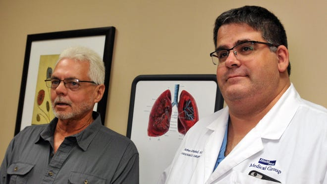 Patient Neil Carlon with Dr. Matt Campbell, a cardiothoracic surgeon at HealthFirst Holmes Regional Heart Center in Melbourne.