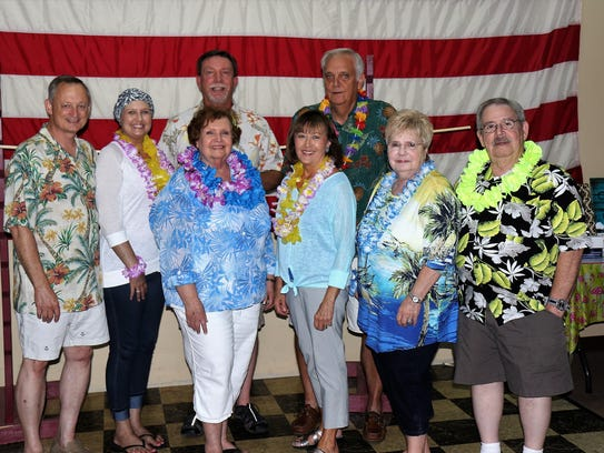 From left, front row: Dressed for the Luau are Jan