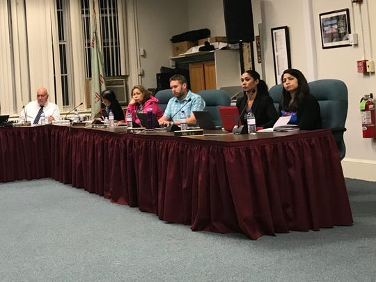 Bloomfield Schools Superintendent Salvatore Goncalves, left, and members of the Bloomfield Board of Education listen to the public on Thursday, May 24, 2018.