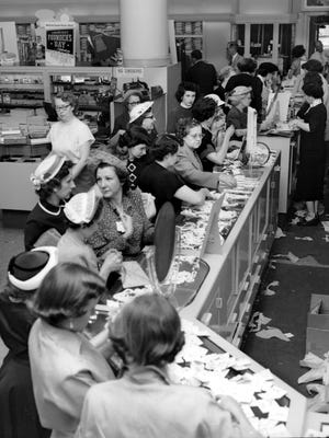 Despite a bus strike, Lowenstein's annual Founder's Day Sale did a day-long brisk business on 29 May 1952, as evidenced by the group of buyers at the costume jewelry counter.