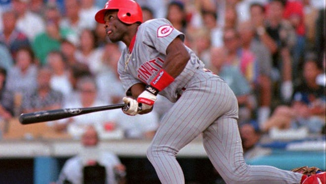 Reggie Sanders watches his two-run homer against the Dodgers on Oct. 4, 1995.