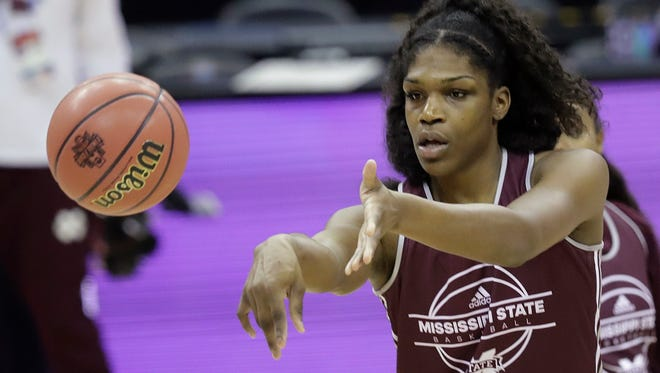 Mississippi State's Teaira McCowan (15) makes a pass during a practice session for the women's NCAA Final Four college basketball tournament, Thursday, March 29, 2018, in Columbus, Ohio. Mississippi State plays Louisville on Friday. (AP Photo/Tony Dejak)