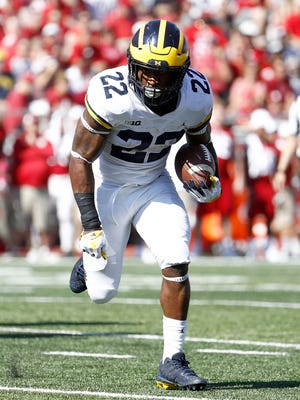 Michigan's Karan Higdon runs for a 12-touchdown against Indiana at Memorial Stadium on Oct. 14, 2017 in Bloomington, Ind.