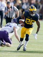 Michigan's Jourdan Lewis broke up the pass to Northwestern's Mike McHugh, back left, then intercepted the ball and returned it for a touchdown October 10, 2015, in Ann Arbor.