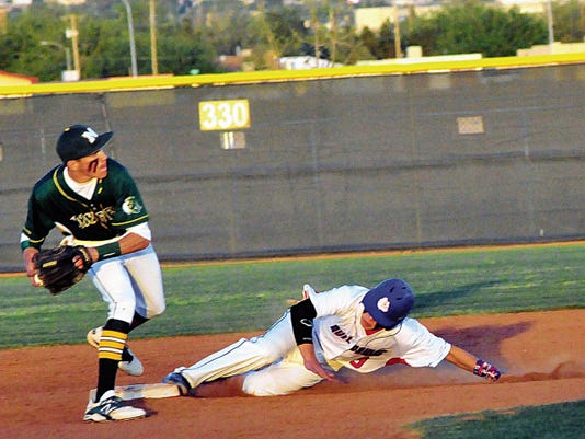 Jaime Guzman for the Sun-News      Trojan shortstop Ethan Alvarado attempts to turn a double play as Bulldawg Tristin Lively slides into second base.