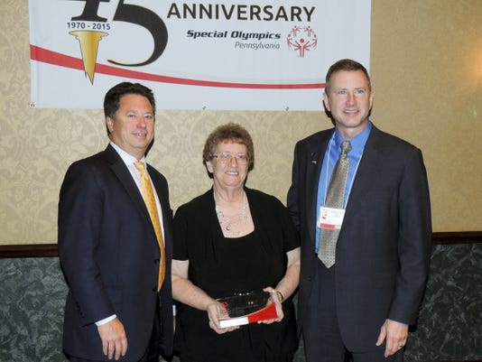 "Bonnie Newton was selected as ""Management Team Member of the Year"" for the state of Pennsylvania, during the Pennsylvania's State Leadership Convention on Sept. 12. From left, are: Greg Stewart, Special Olympics Pennsylvania board chairman; Bonnie Newton; and Matt Aaron, president and CEO of the State organization. There are 58 local Special Olympics programs with over 700 management team members across Pennsylvania so Newton's selection is quite an achievement. With more than 25 years of experience as a coach, volunteer coordinator, mentor and friend to Adams County's Special Olympics athletes, Newton has had a tremendous impact on the Adams County program by providing positive motivation to athletes and acting as role model for other local volunteers."