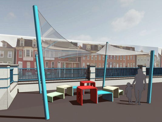 CORE-Design Group worked with Lincoln Charter School to design a unique Buddy Bench for the school's playground, shown here in an artist's rendering.