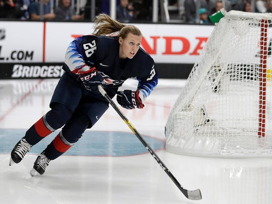 FILE - In this Jan. 25, 2019, file photo, United States' Kendall Coyne Schofield skates during the Skills Competition, part of the NHL All-Star weekend, in San Jose, Calif. Coyne Schofield says she doesn't believe NBC Sports analyst Pierre McGuire questioned her knowledge of the sport during an awkward pre-game interaction. McGuire was criticized on social media for telling Coyne Schofield which sides the Penguins and Lightning were on during their broadcast of the game on NBC Sports Network on Wednesday night and for saying the network was paying her to be an analyst and not a fan. (AP Photo/Ben Margot, File)