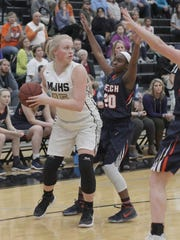 Mt. Juliet's Emma Palmer is guarded by Beech's Shyia