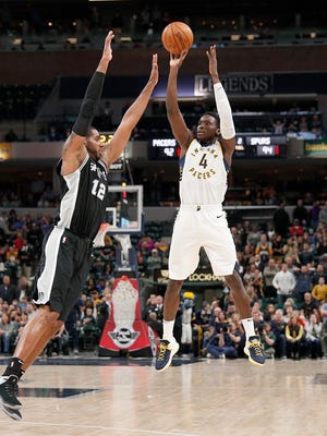 Indiana Pacers guard Victor Oladipo (4) hits the game winning 3-pointer over San Antonio Spurs forward LaMarcus Aldridge (12) with 10 seconds left in their game at Bankers Life Fieldhouse Sunday, Oct. 29, 2017.  The Indiana Pacers defeated the San Antonio Spurs 97-94.