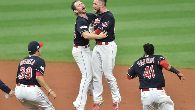 Oct 6, 2017; Cleveland, OH, USA; Cleveland Indians starting pitcher Josh Tomlin (left) and catcher Yan Gomes (right) celebrate after game two of the 2017 ALDS against the New York Yankees at Progressive Field.