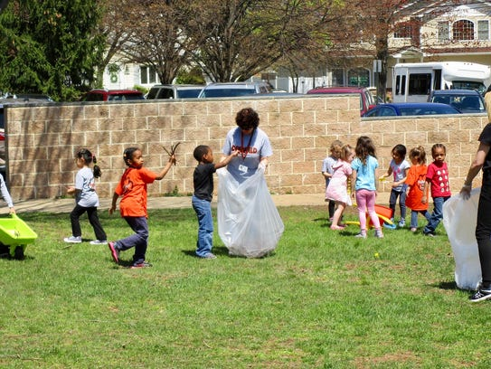 Pre-K and kindergarten students spread out to clean