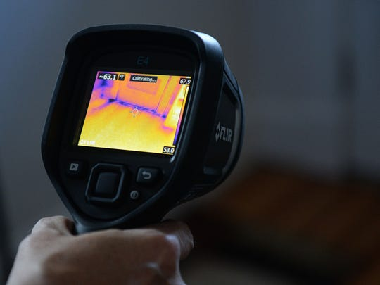 An infrared camera shows cold air coming in from under a door during an energy audit at the home of Barbra Libeler and Bill Jenkins on Thursday, November 19, 2015.